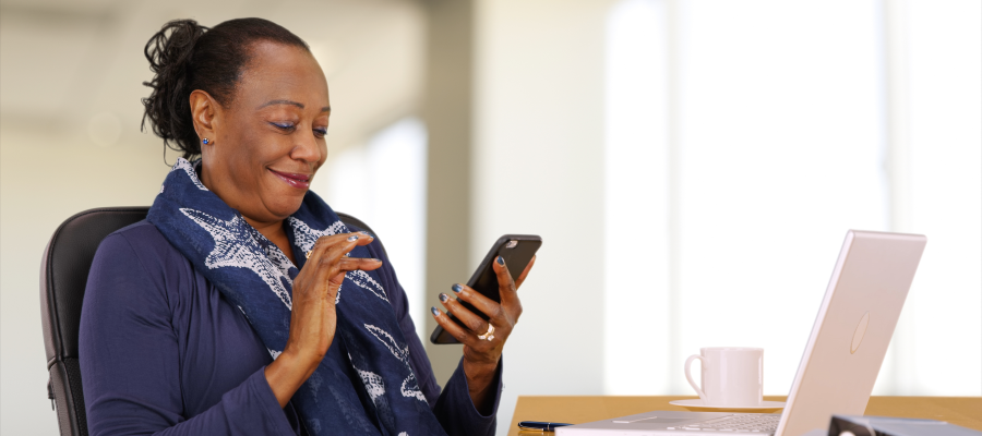 Church Giving The Truth About Tithing African American woman smiling at the phone she's holding