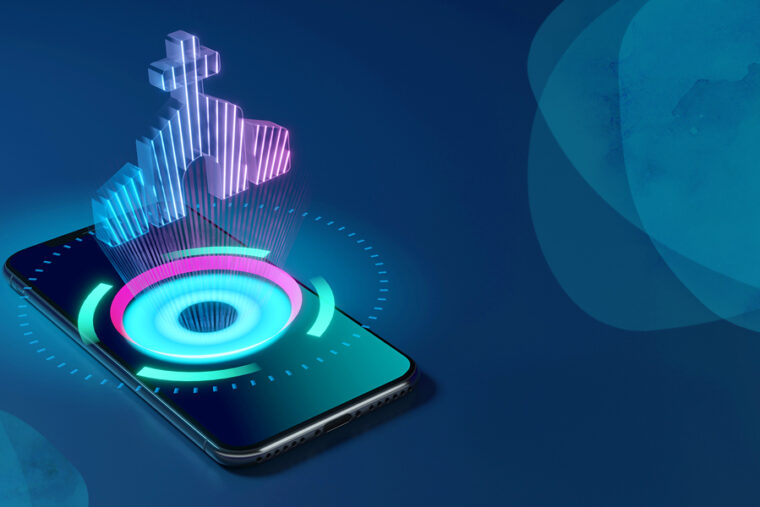 Easter Giving 2021. Photo shows a phone with a hologram looking church coming out of it. This signifies that some Easter services will be digital, some will be physical and some will be a combination of both - 'phygital.'